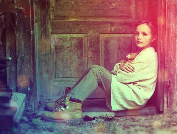 Sad little girl feels lonely